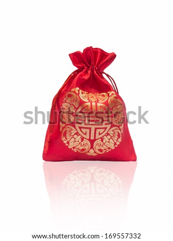 Red silky money bag : Lucky Pouch Chinese tradition for Chinese new year holiday.isolated - stock photo