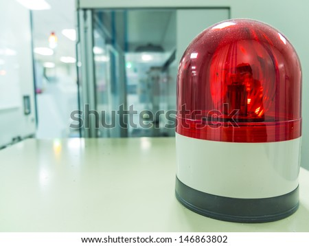 Red siren/light in factory. - stock photo