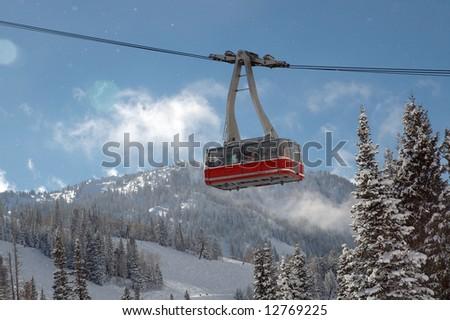 Red Ski tram over ski resort at Snowbird, Utah - stock photo