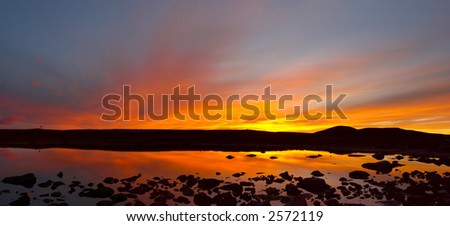 Red sky and lake. Altay. Russia. - stock photo