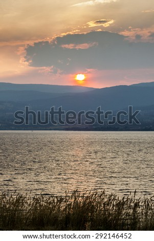 Red Sky Sunset from Forest Fire in Mountain Area - stock photo