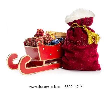 Red sleigh full of christmas presents and Santa Claus bag over white background - stock photo