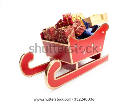 Red sleigh full of christmas presents over white background - stock photo
