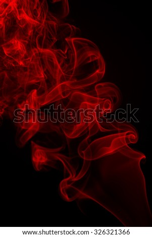 Red smoke abstract on dark background - stock photo