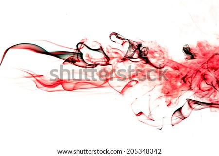 Red smoke on white background. - stock photo