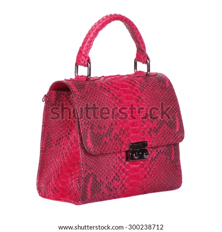 Red snake leather bag isolated on white background