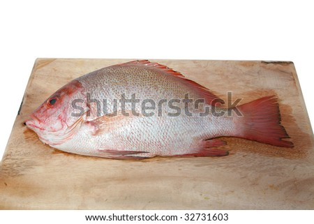 red snapper on cutting board - stock photo