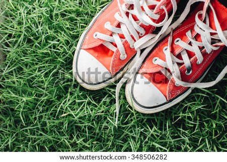 Red Sneakers on grass background