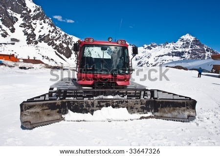 Red snow-cat ready to work in snow. - stock photo