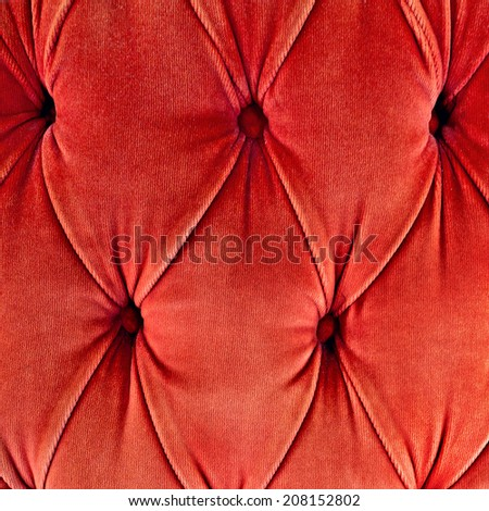Red sofa upholstery velvet fabric pattern background