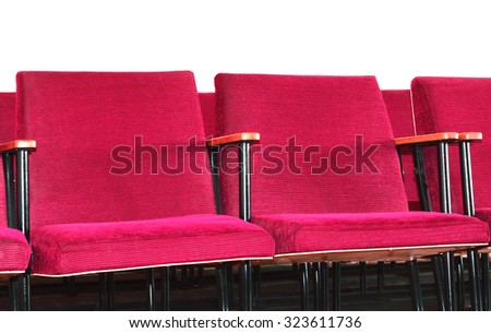 Red soft spectator armchair on a white background