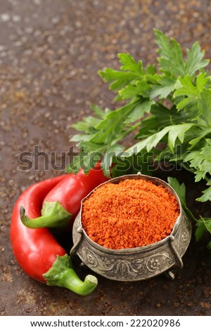 red spice paprika pepper on iron old background - stock photo