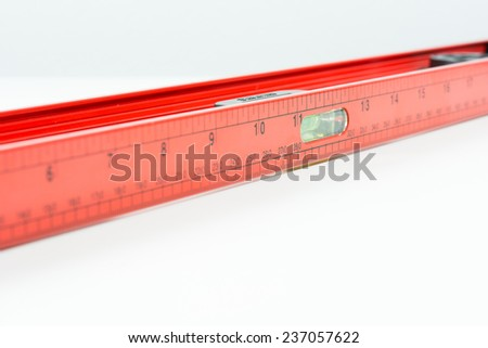 Red spirit level isolated on over white background - stock photo