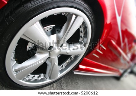 Red Sport Car Wheel - stock photo