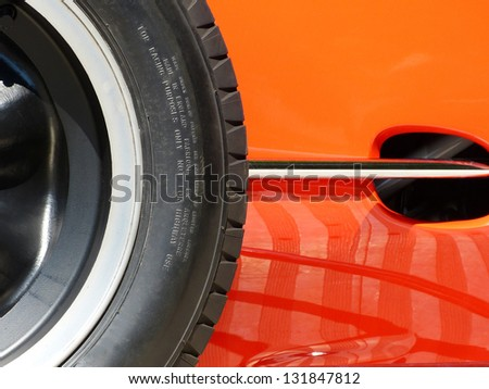 Red Sports Car and Wheel Side detail photograph - stock photo