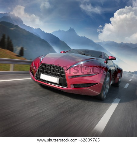 Red sports car moving on the mountain road. Original car design. - stock photo