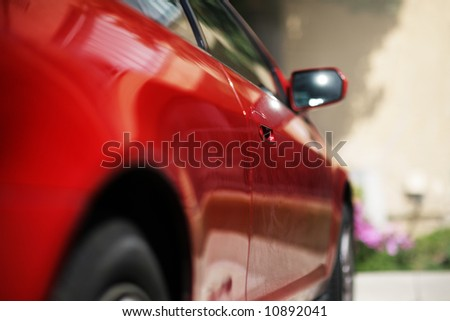 Red sporty car detail, close-up, shallow DOF. - stock photo