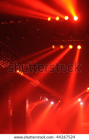 Red spot lights in a music concert - stock photo