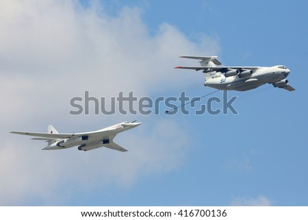 RED SQUARE, MOSCOW, RUSSIA - MAY 7, 2016: Tupolev Tu-160M (NATO: Blackjack) strategic bomber and Ilyushin Il-78M tanker of Russian Air Force imitating refuelling during Victory Day parade rehearsal.