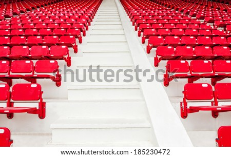 red stadium seat - step stairs clean plastic sit background show seating chair perspective - stock photo