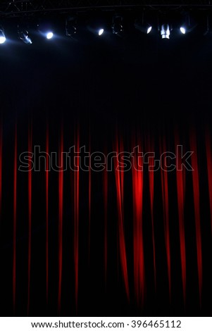Red stage curtain and the lights, background - stock photo