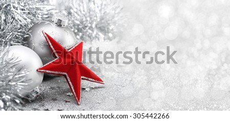 Red star and Christmas balls on abstract background - stock photo