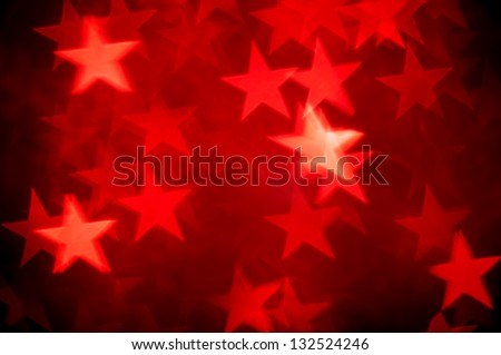 red stars bokeh as background - stock photo