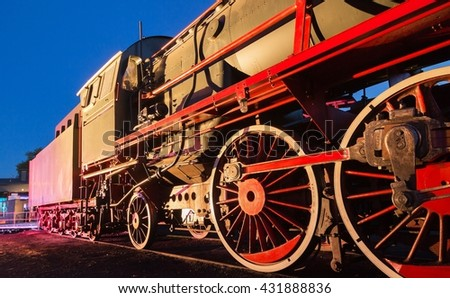 red steam train at night