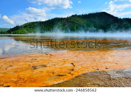 red steamy surface of the Midway Geyser Basin in Yellowstone National Park, Wyoming - stock photo