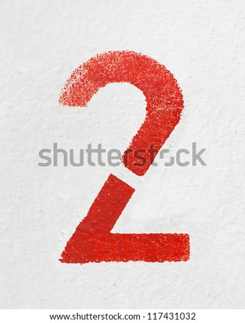Red stenciled number Two on old painted wall - stock photo