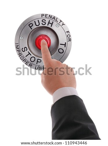Red STOP button pressed by businessman's finger - stock photo