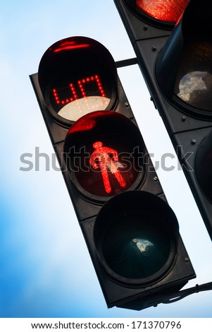 Red stop signal with timer on street pedestrian traffic light - stock photo