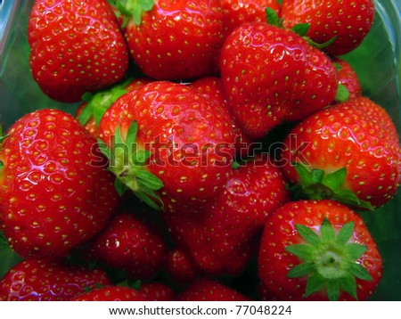 Red strawberries close up in the market