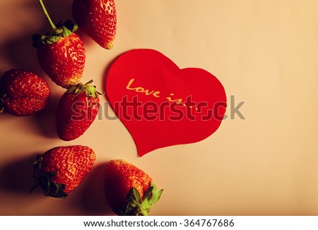 Red strawberry and red papper gift card for lovers - stock photo