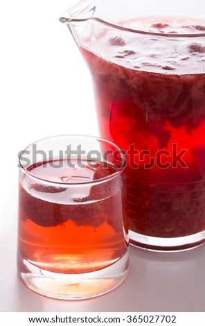 Red strawberry drink. Summer fruit compote on a white background. - stock photo
