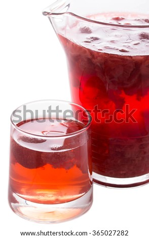 Red strawberry drink. Summer fruit compote on a white background. Isolated photo. - stock photo
