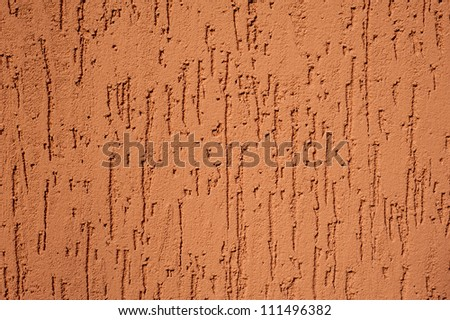 red striated stucco wall texture - stock photo
