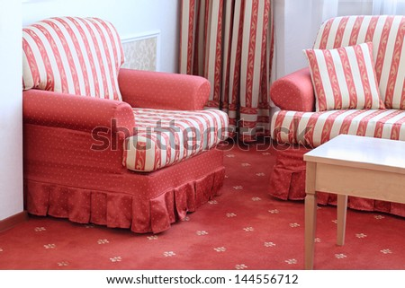 Red Striped Sofa With Pillow And Armchair In Stylish Comfortable Room.