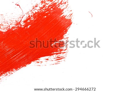 Red stroke of the paint brush on white paper