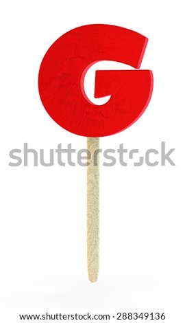 red sugar candy in the form of a letter G on a wooden stick - stock photo