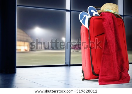 red suitcase and red towel  - stock photo