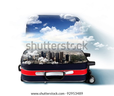 Red suitcase with city on the horizon and blue sky inside - stock photo