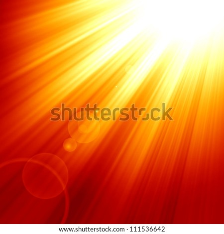 Red sun with an intense glow and sun beams