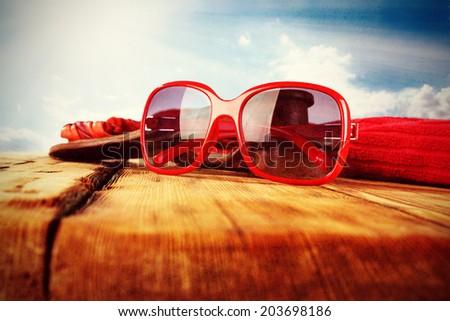 red sunglasses on desk  - stock photo