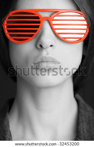 red sunglasses on the gorgeous woman face - stock photo
