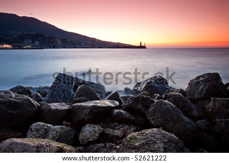 red sunrise over black sea coastline. Yalta, Ukraine