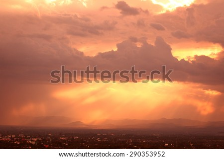 Red sunset over the city covered by clouds - stock photo