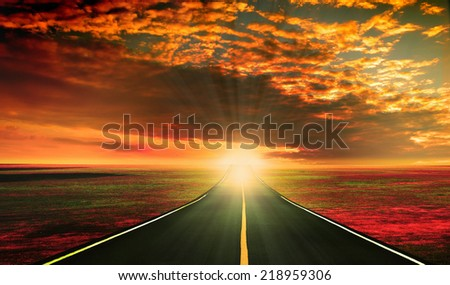 Red Sunset over the Road to the Horizon - stock photo