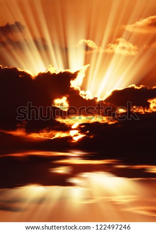 Red sunset over the sea, rich in dark clouds - stock photo