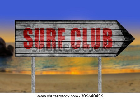 Red Surf Club wooden sign with on a beach background - stock photo